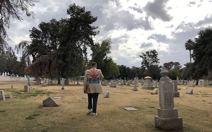 'Hip Historian' Marshall Shore walks through the Greenwood Memory Lawn Mortuary & Cemetery in Phoenix. - KATELYN KEENEHAN/CRONKITE NEWS