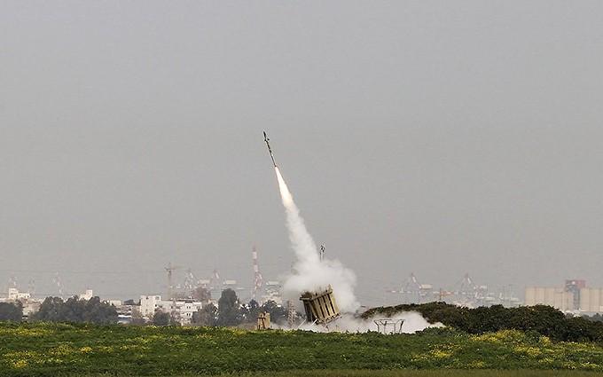 An Iron Dome launcher fires an interceptor rocket near the southern city of Ashdod, Israel. - RAYTHEON