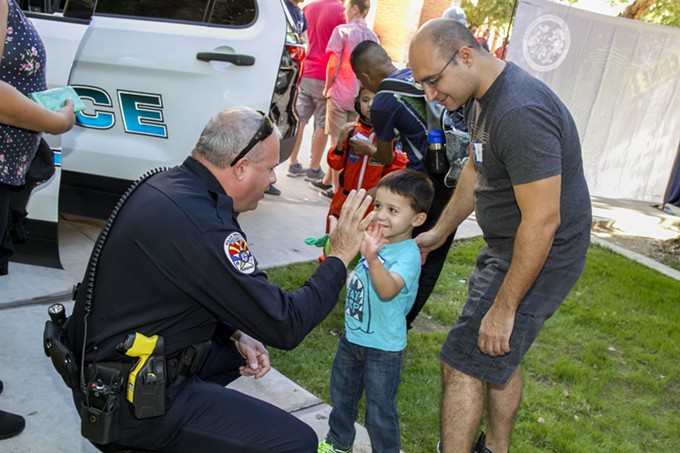 Chandler police have increased training around interactions with people who have intellectual or developmental disabilities through such events as Pizza With a Cop in 2019. - CHANDLER POLICE DEPARTMENT