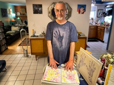 """David LaRussa at home with his art: """"I'm just into hands."""" - BRIAN SMITH"""