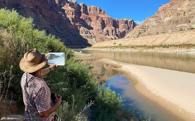 Research scientist Seth Arens matches a historic photo in Cataract Canyon in October 2020. - GLEN CANYON INSTITUTE