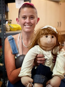 Volunteer Jules and doll. - BRIAN SMITH