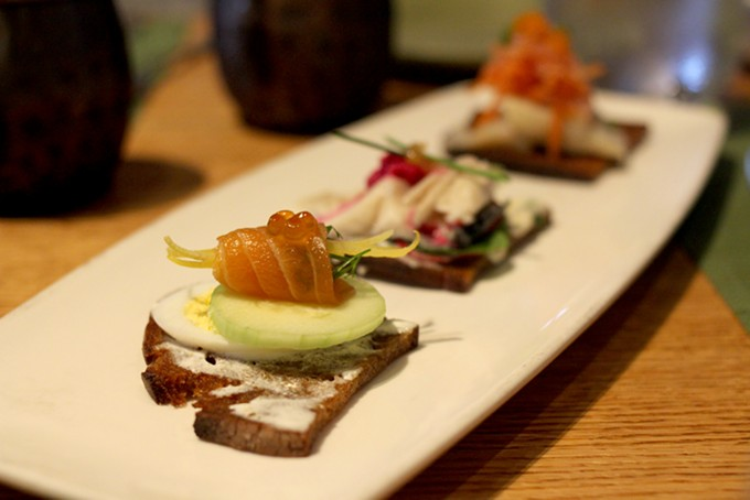 Smoked fish took center stage atop Barrio rye bread for one of the starters on Downtown's Moscow menu. - HEATHER HOCH