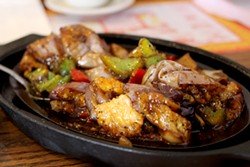 Sizzling shrimp with soft eggplant is a unique dish with tons of flavor. - HEATHER HOCH