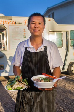 Nhu Lan's owner Nghia Tran dishes up pho dac biet. - JD FITZGERALD