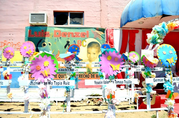 Shrine outside the ruins of the ABC Day Care for 49 toddlers who died in a fire seven years ago. - MARIA INES TARACENA