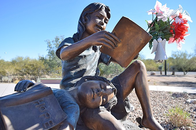 A statue of children in Christina-Taylor Green Memorial park represents the joy and innocence of all children.
