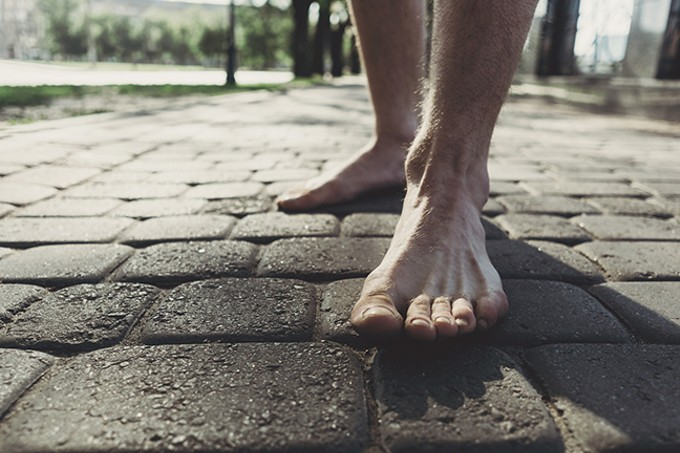 bigstock-man-bare-feet-stepping-on-pave-244512781.jpg
