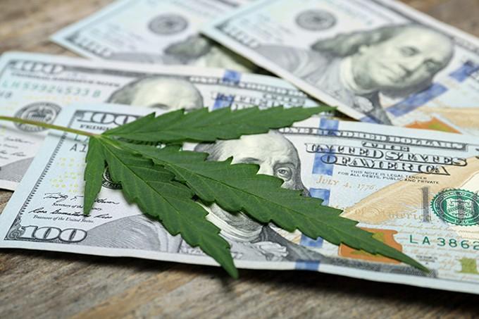 bigstock-hemp-leaf-and-money-on-wooden--257285155.jpg