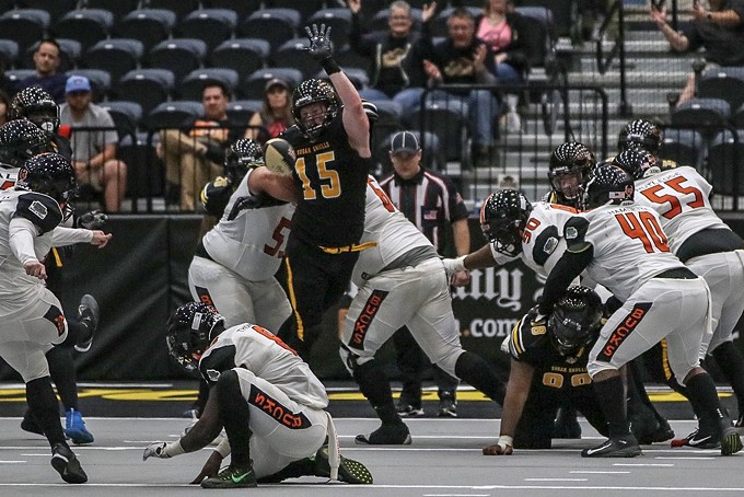 Tucson Sugar Skulls linebacker Robert Metz attempts to block a field goal kick against the Bismarck Bucks on March 10.