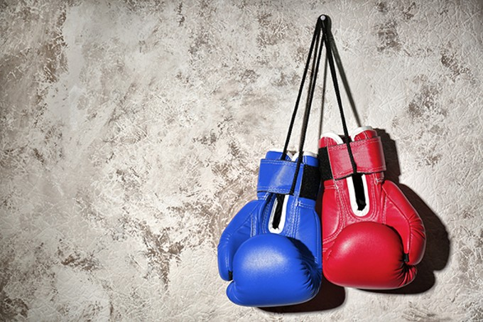bigstock-red-and-blue-boxing-gloves-han-228079651.jpg