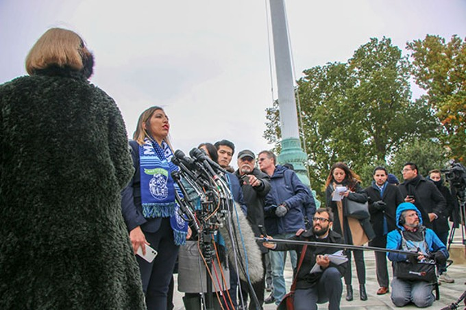 Lindsay Walker/Cronkite News One of the plaintiffs addresses a cheering crowd outside the Supreme Court after it heard arguments over whether the Trump administration can overturn DACA.