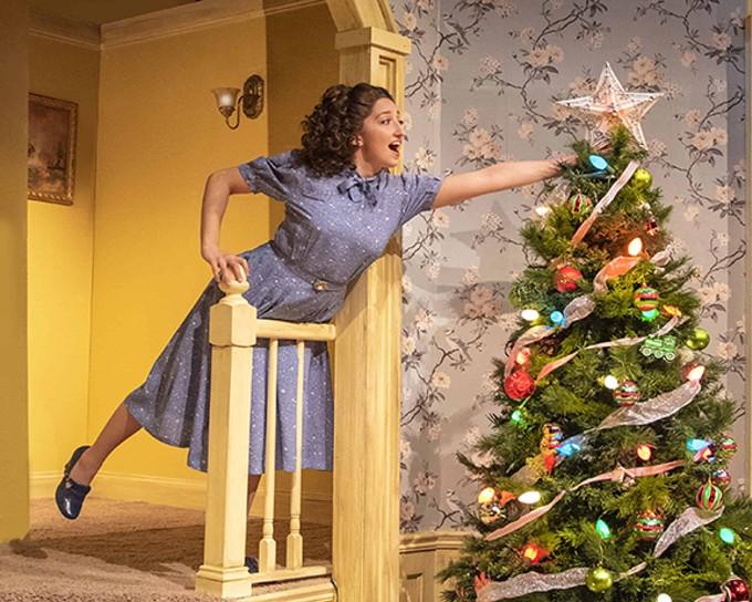 Lala (Carly Natania Grossman) trims the tree in The Last Night of Ballyhoo