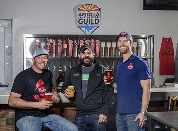 Matt Gordon from Sentinel Peak (left), Es Teran from Borderlands (center) and Taylor Carter of Sentinel Peak inside their taproom at 330 S. Toole Ave., next to Rocks and Ropes. The two brewing companies joined to form Arizona first co-op, Voltron Brewing.