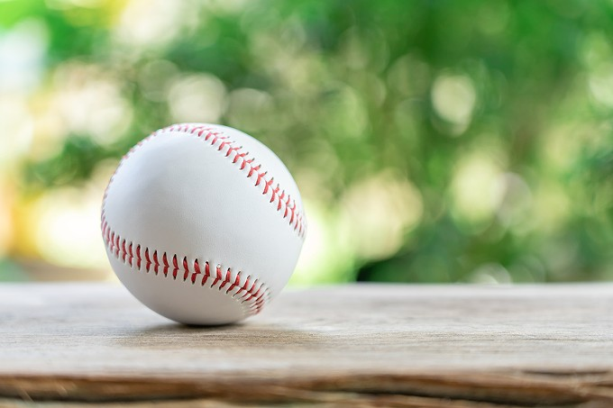 bigstock-baseball-on-abstract-backgroun-305513374.jpg