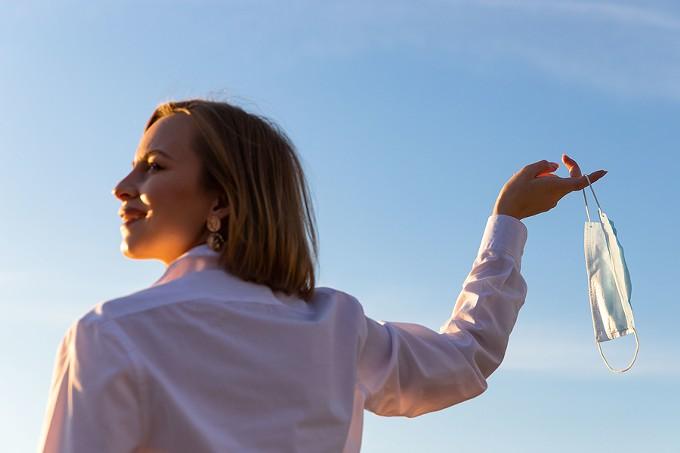 bigstock-happy-woman-takes-off-medical--364636564.jpg