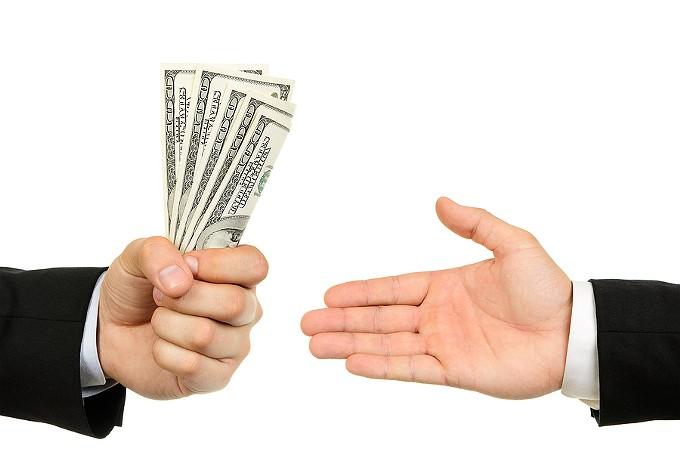 bigstock-hand-handing-over-money-to-ano-66037201.jpg