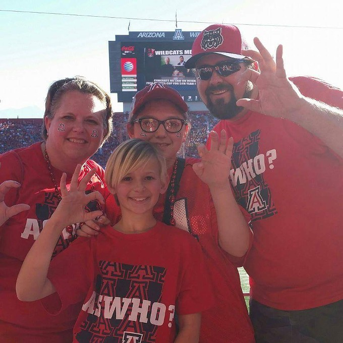 The Wagners, from left to right, Jen, Sam, Karl, Julia, front, at a UA football game.
