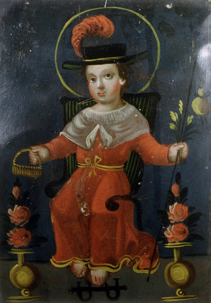 A Mexican retablo picturing Santo Niño de Atocha, a patron saint of migrants. Cropped, artist unknown. From the Giffords Collection, courtesy of Arizona State Museum