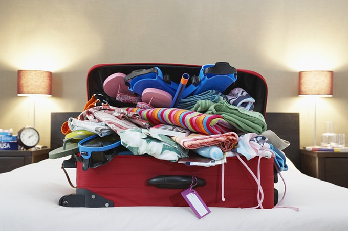 bigstock-open-suitcase-on-bed-49203935.jpg