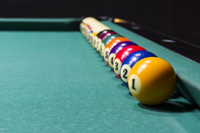 bigstock-billiard-table-with-colorful-b-79725547.jpg