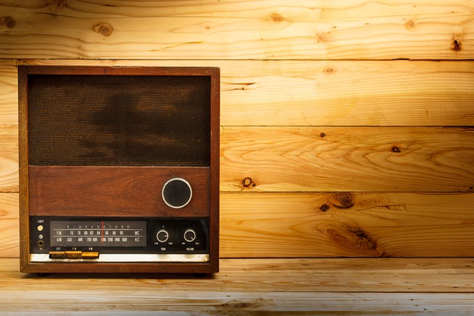 bigstock-old-retro-radio-with-light-on--77222264.jpg