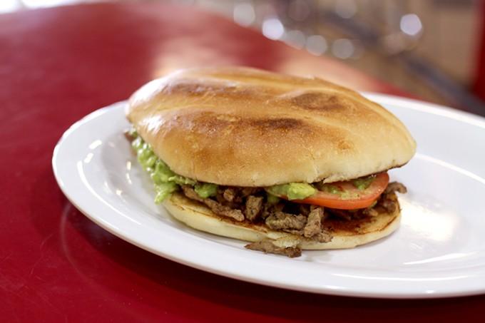 The toasted bun and generous portion of guacamole on the Taqueria El Pueblito torta make it shine.
