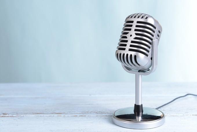bigstock-vintage-microphone-on-table-on-69454279.jpg