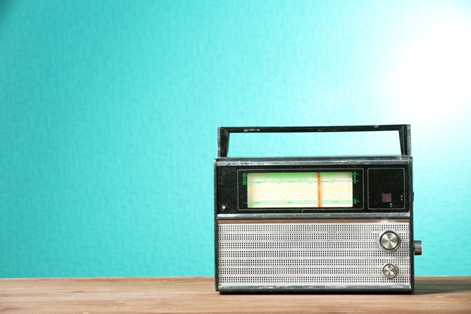bigstock-old-retro-radio-on-table-on-gr-91476866.jpg