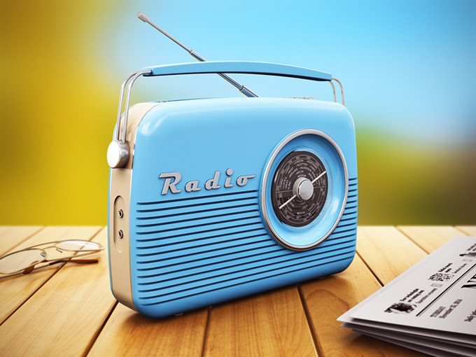 bigstock-old-radio-on-wooden-table-outd-74532778.jpg