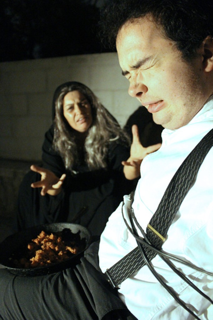 "Sarah MacMillan and Elliot Scott in a scene from ""Gnawing the Bone."""
