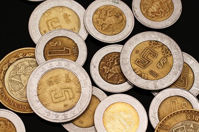 bigstock-mexican-pesos-on-black-80585882.jpg