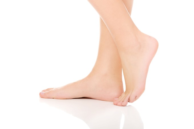 bigstock-woman-s-smooth-bare-feet-with--87788129.jpg