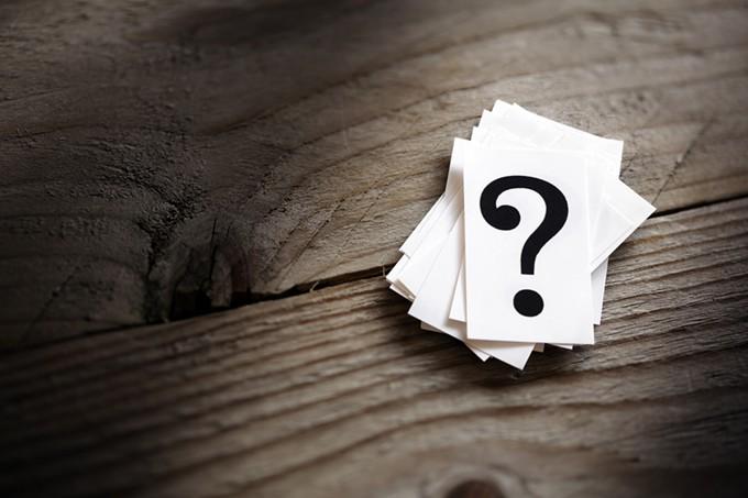 bigstock-question-mark-heap-on-table-co-86579810.jpg
