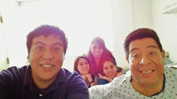 Josue Saldivar, left, with his dad, mom and younger sisters at the hospital in Albuquerque.