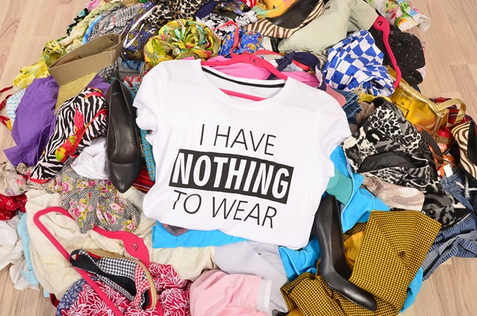 bigstock-big-pile-of-clothes-thrown-on--108646775.jpg