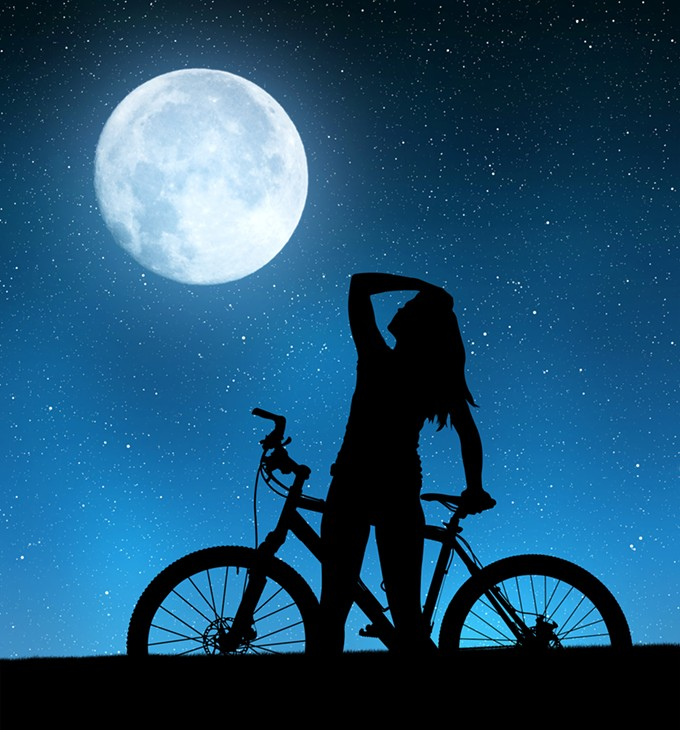 bigstock-girl-on-a-bicycle-in-night-sky-99377102.jpg
