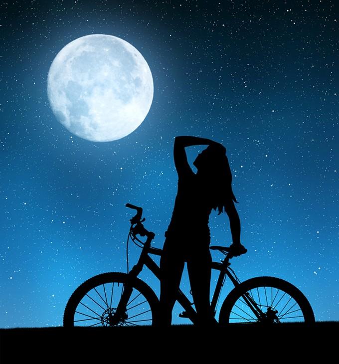 bigstock-girl-on-a-bicycle-in-night-sky-99377102.jpg