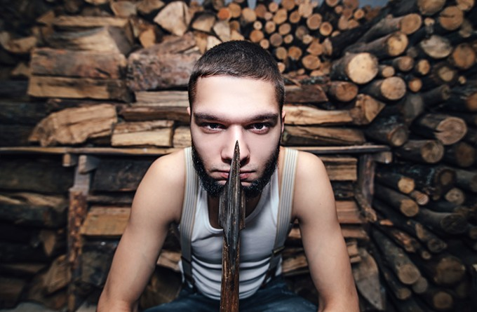 bigstock-man-with-an-ax-near-firewood-s-121804397.jpg