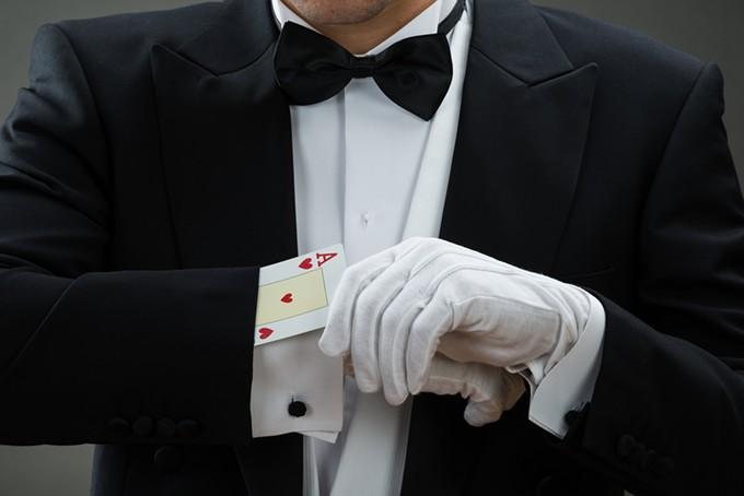 bigstock-magician-performing-magic-tric-108868511.jpg
