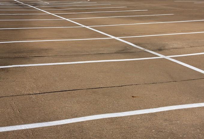 bigstock-empty-parking-spaces-9049519.jpg