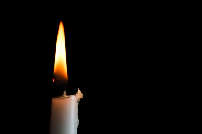 bigstock-single-candle-left-65367061.jpg