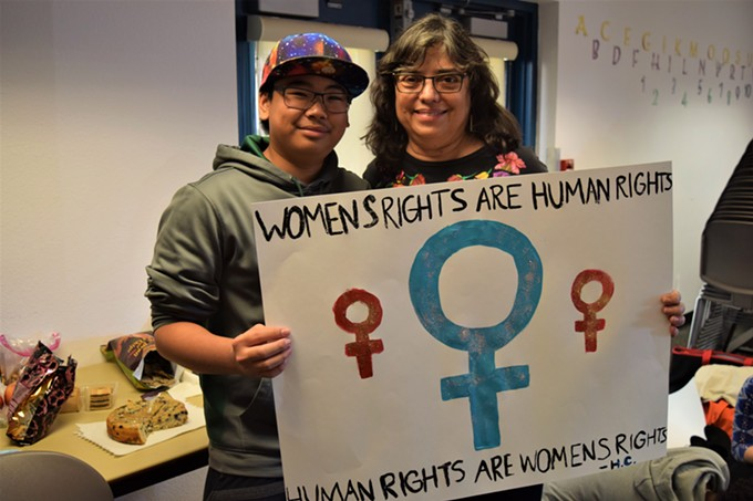 Tucson March co-organizer Marea Jenness and her son Daniel, 16, hold a sign they made to carry at the March.