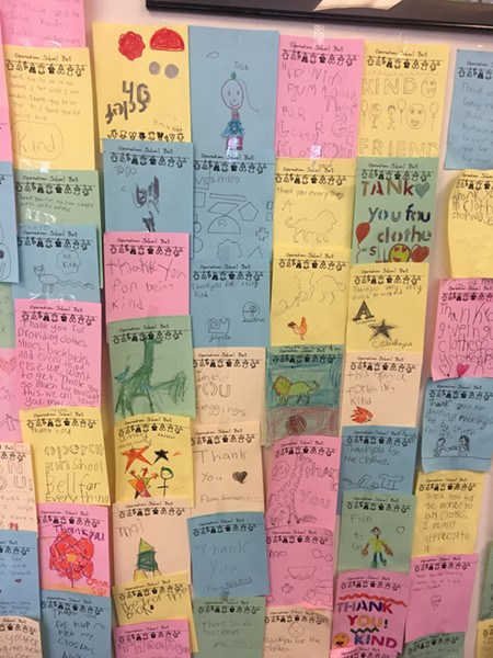 """Children participating in Operation School Bell write thank you notes before their turn to """"shop"""" for clothes. - MELISSA VASQUEZ"""