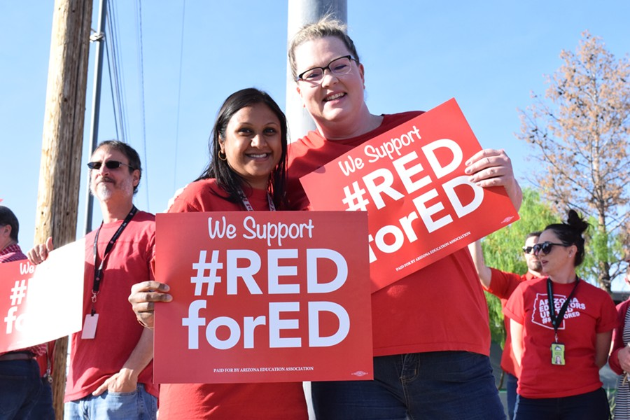 Along with many Tucson schools, educators at Amphitheater High School hold a Red for Ed walk-in before school on April 11. - DANYELLE KHMARA