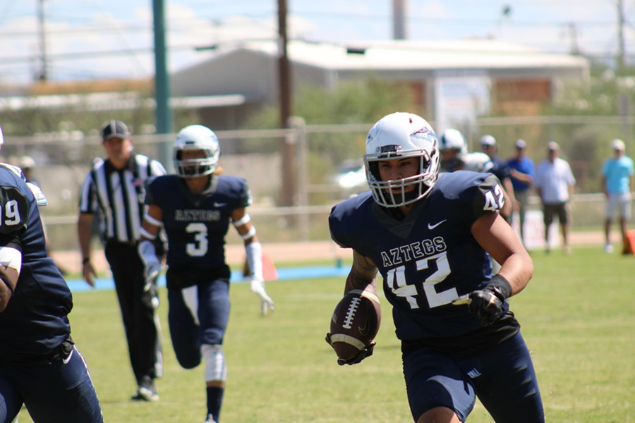 Austyne Carvalho-Toloai races down field with the ball during a 2017 football game with the Pima Community College Aztecs. - COURTESY PHOTO