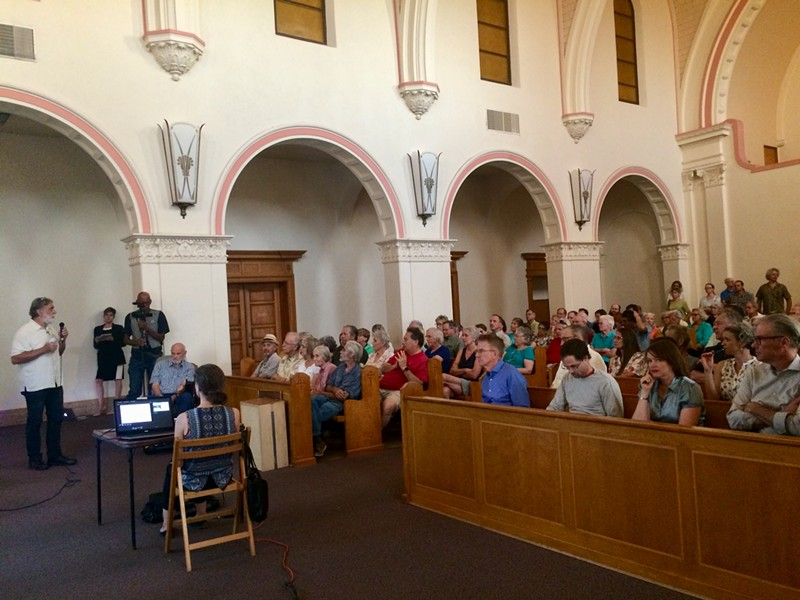About 100 neighbors and people invested in the outcome of the Benedictine Monastery gather on June 28 to hear architect Corky Poster's latest proposal for the sanctuary's future. - DANYELLE KHMARA