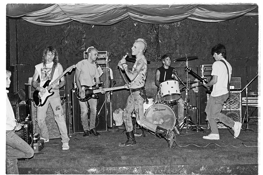 """""""Civil Death at The Backstage on 4th Ave., May 13, 1983. Civil Death was a Tucson band formed by singer Lenny Mental, drummer Nick Johnoff and guitarist Zach Hitner. My friend Paul Young, who has since passed away, joined in late 1983 on guitar.  Paul used to let me get on his shoulders during shows to take photographs above the crowd. Pictured is Paul Young on guitar, Johnny Glue on bass, Lenny Mental on vocals, Nick Johnoff on drums and Zach Hitner on guitar."""" - ED ARNAUD"""