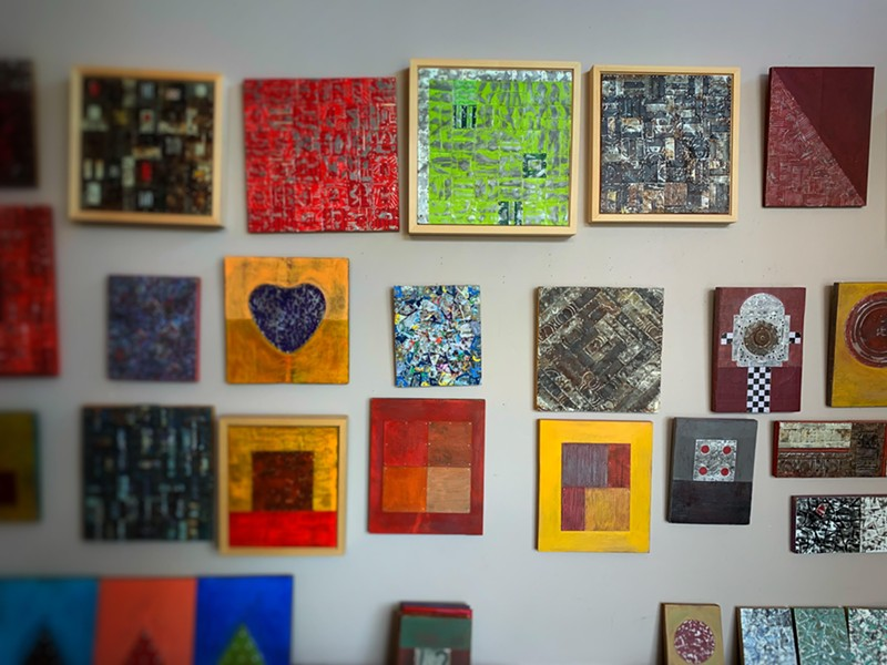 A wall of Alvaro Enciso's art inside his home. - BRIAN . SMITH