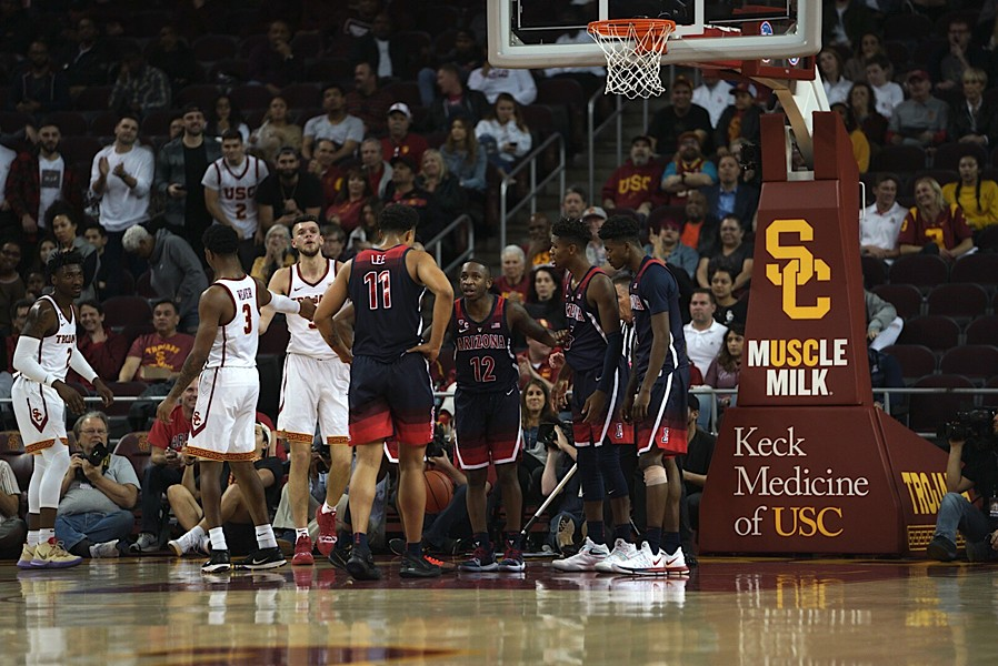Members of the Arizona basketball team mill about the court at Galen Center during the team's 80-57 loss to Southern California on Thursday. - CONNOR BUSS, FOREWORD FILMS